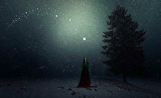 夜空に祈る女性